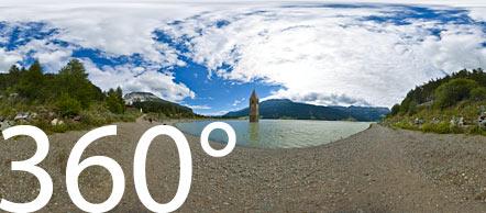 Der Reschensee - ein Paradies für Kitesurfer und zugleich ein ein historisches Mahnmal